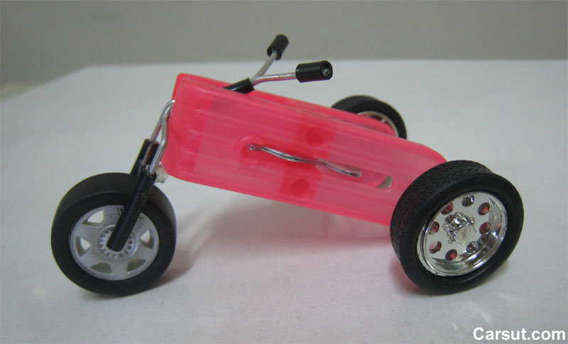 build a rubber band powered car but it requires some skills to build